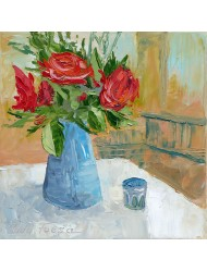 Red roses in a blue jug