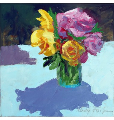 Red and yellow roses in a blue jug
